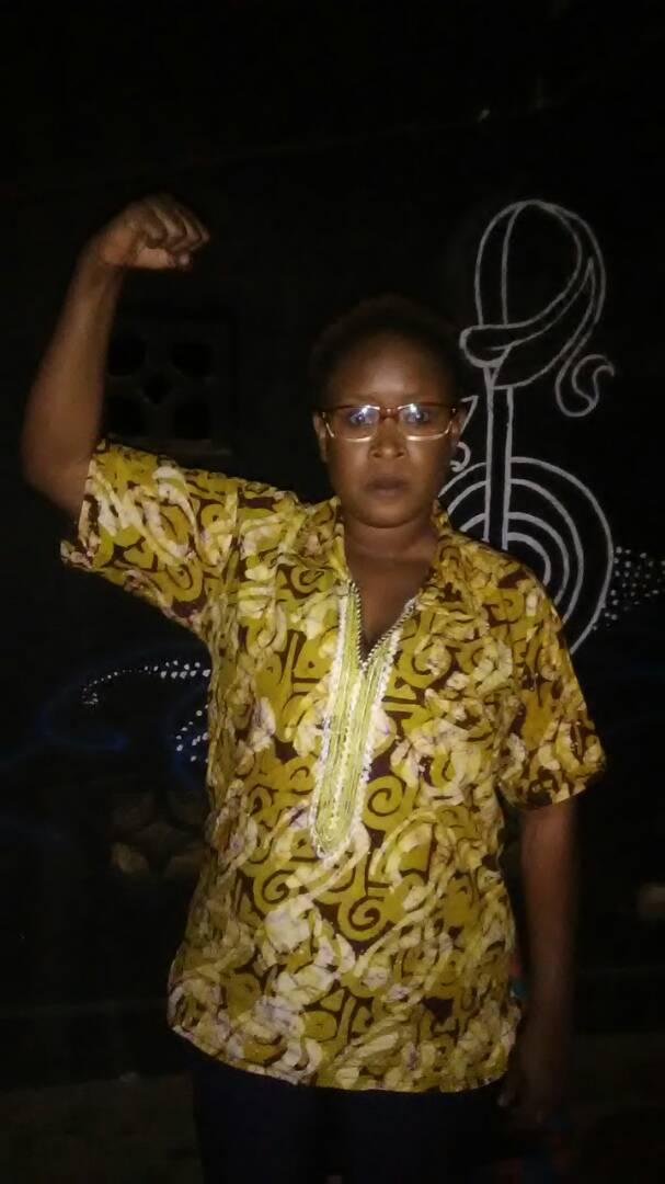 Malawi actress holding up a fist