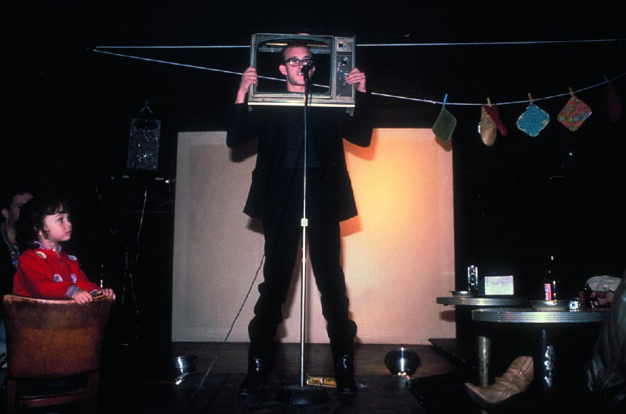 a man holding a TV frame on his head