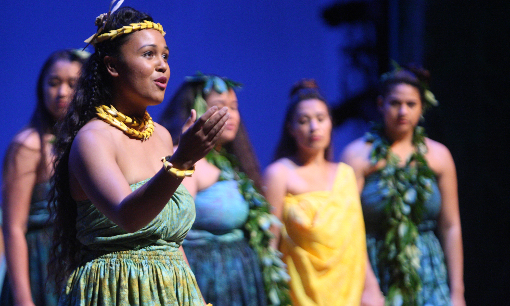 group of Hawaiian performers singing onstage