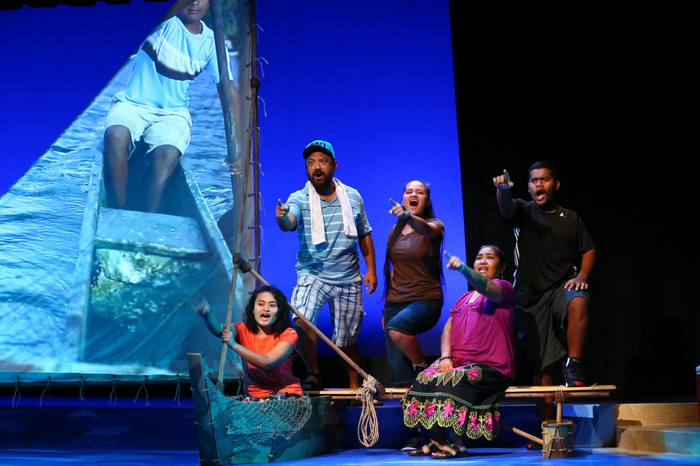 actors on a boat onstage