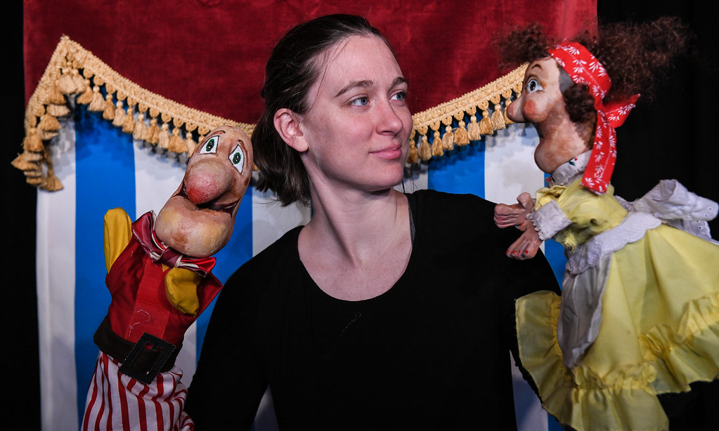 an actor with two hand puppets