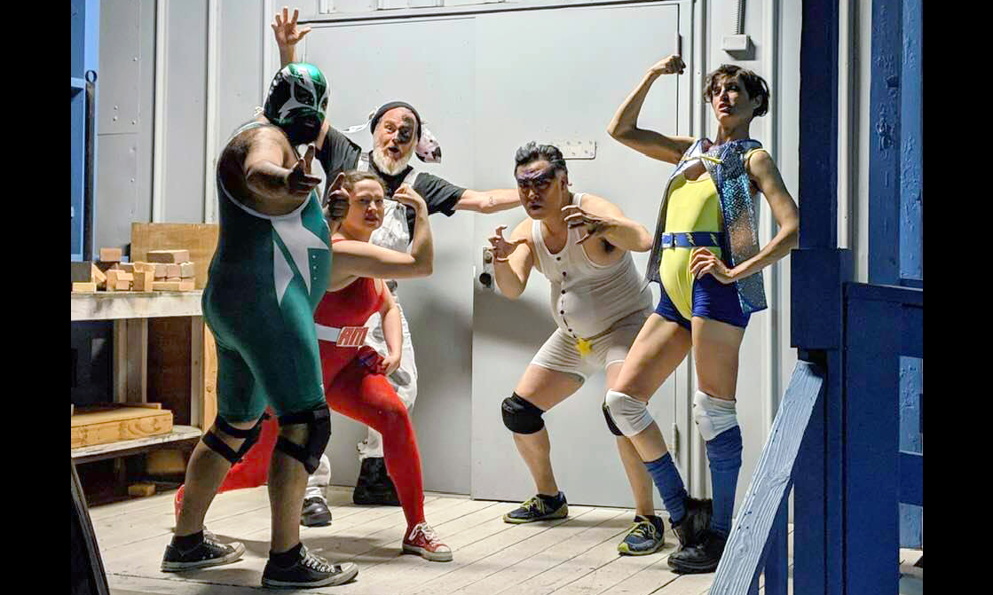 five actors dressed as wrestlers