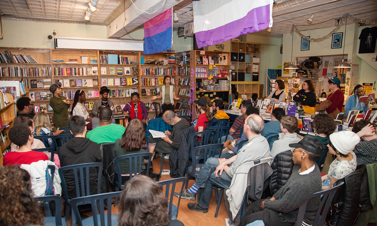 a large group seated in a bookstore