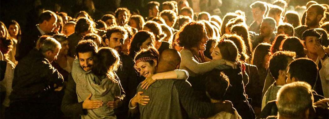 a crowd of people hugging each other