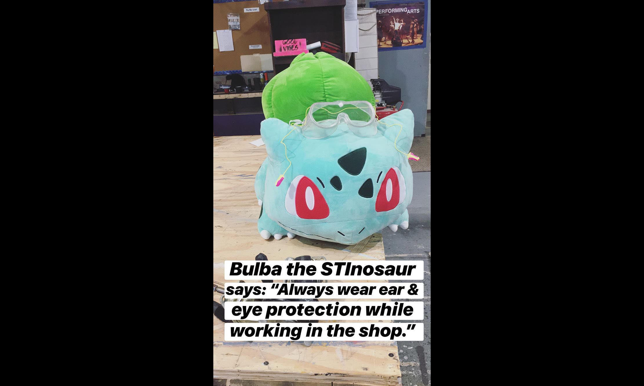 "photo of a stuffed bulbasaur with the caption ""Bulba the STInosaur says: 'Always wear ear & eye protection while working in the shop.'"""