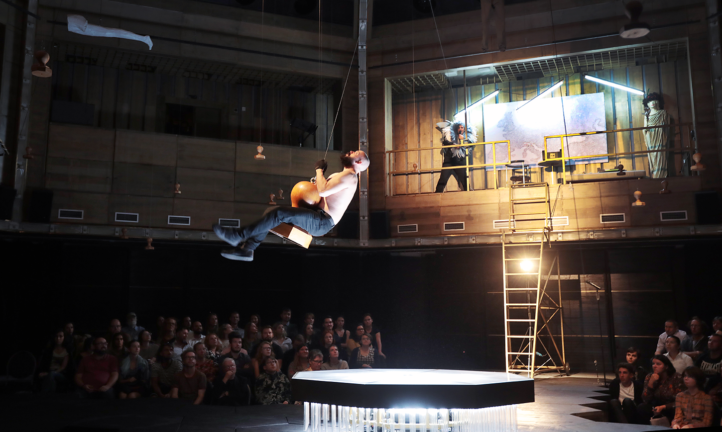 an actor swinging above stage