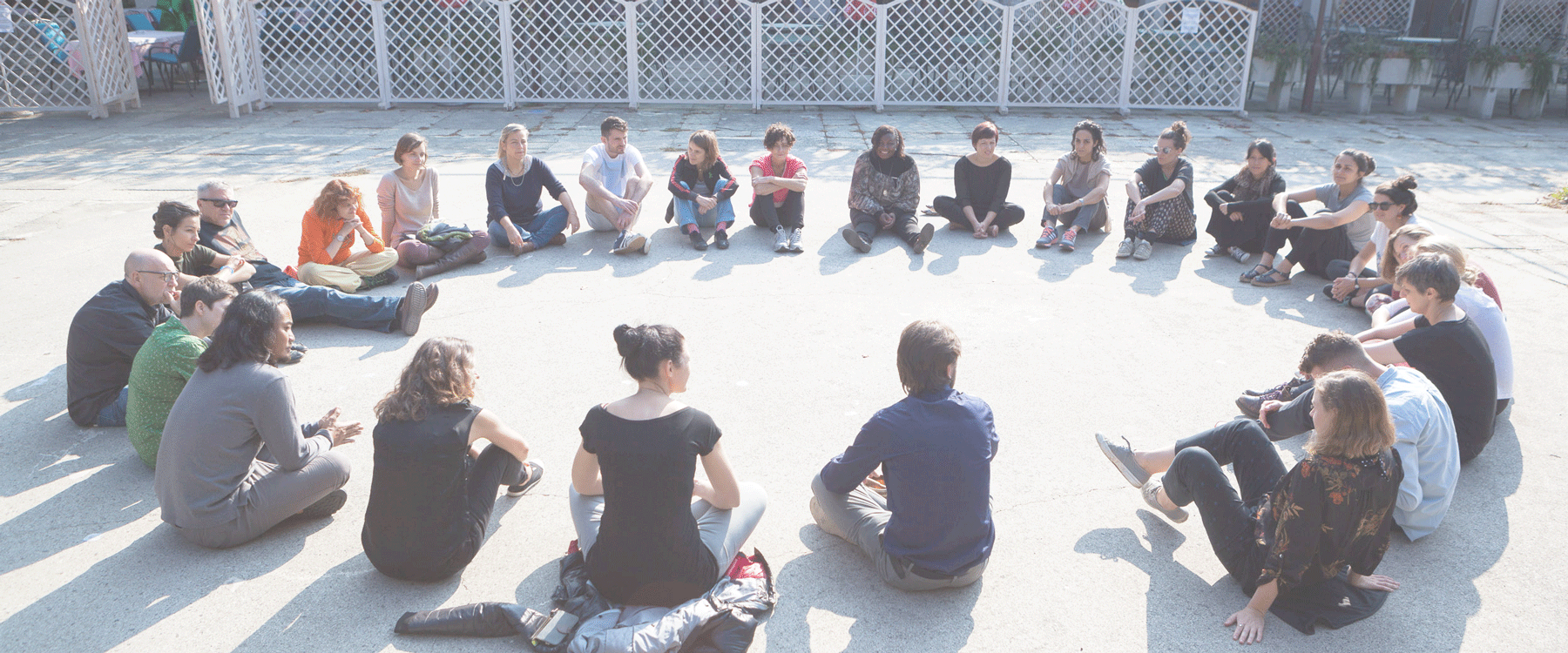 a large group sitting in a circle