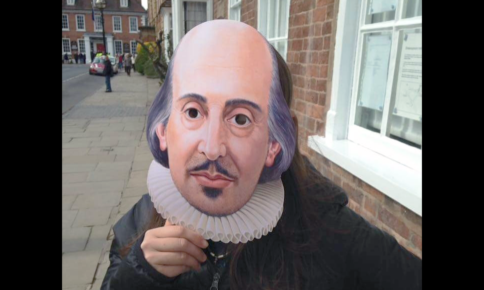 madeline sayet holding a paper shakespeare mask