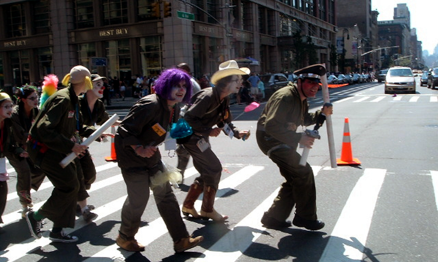 a group of clowns crossing a street