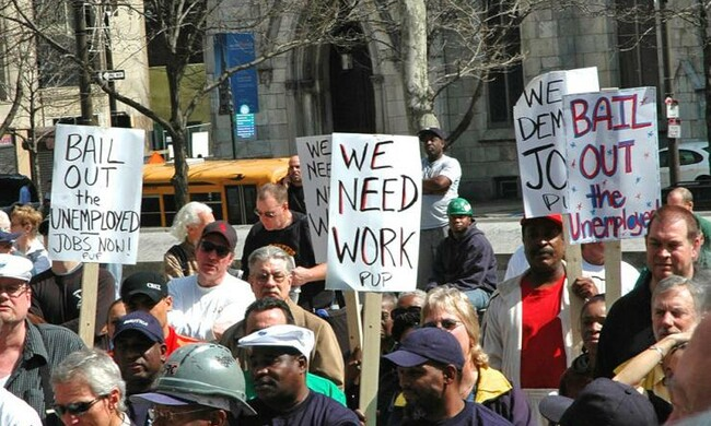 People with signs protesting unemployment in the United States.