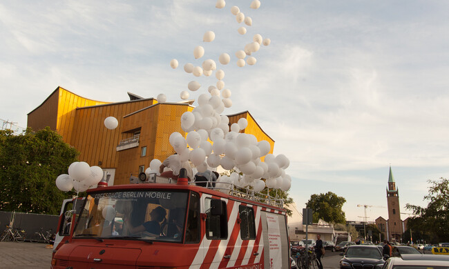 balloons flying out of the van of a roof