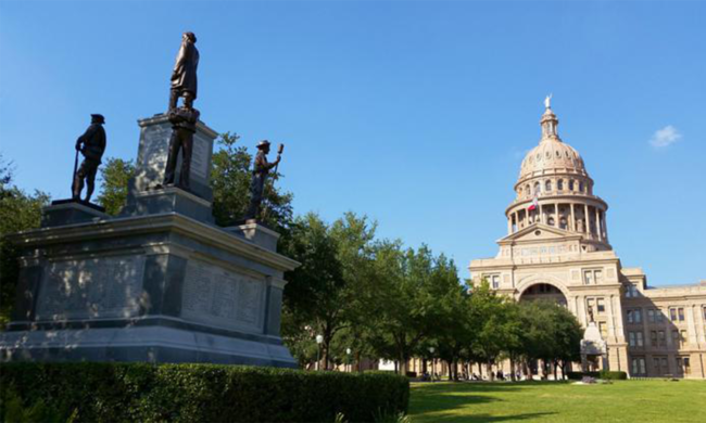 A statue and a building in Austin, Texas.