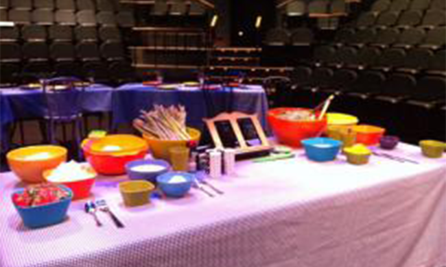 Several colorful bowls filled with ingredients on a table.