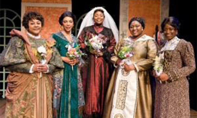 Five women in period dress.