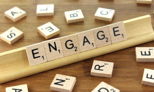 Scrabble letter arranged to spell the word engage.