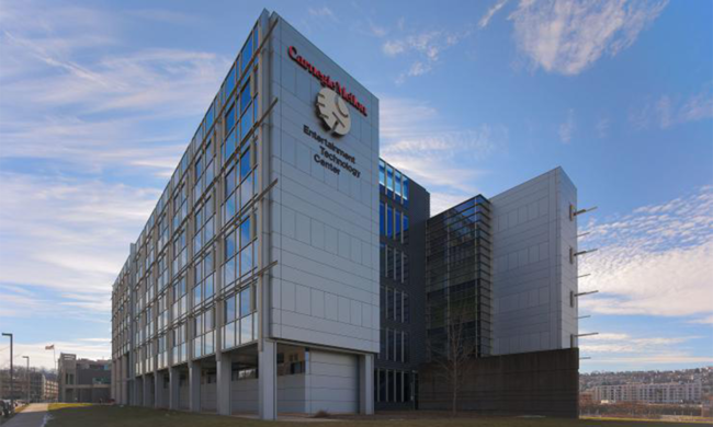 A large office building with a sign that says Carnegie Mellon Entertainment Technology Center.