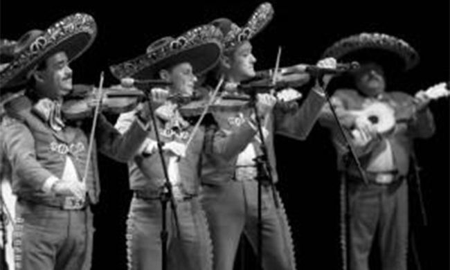 A black and white photo of a mariachi band.