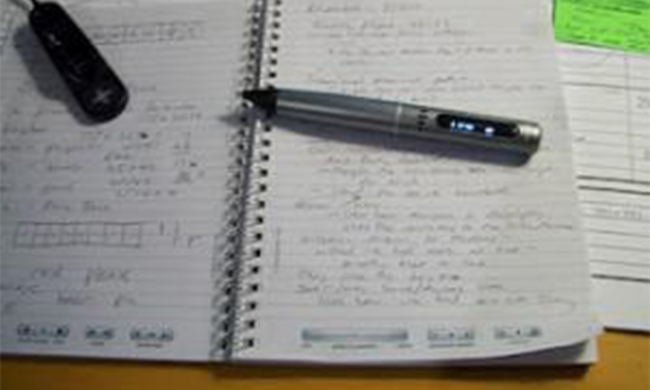 A notebook with the LiveScribe pen on top of it.