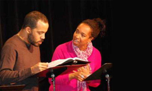 Two people reading scripts.