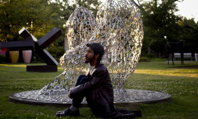 A man in a sculpture garden.