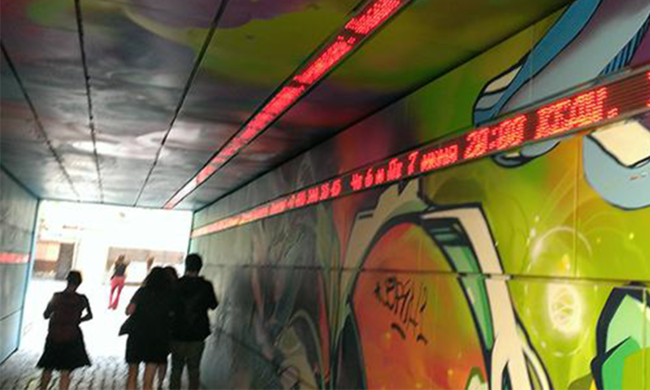 A tunnel covered in graffiti.