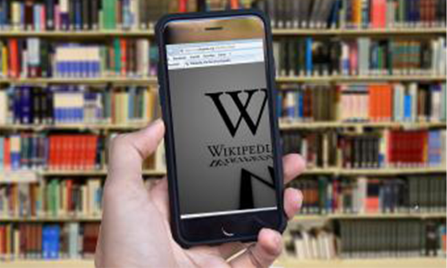 A phone opened to a wikipedia page.