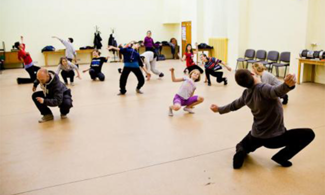 A room of children dancing.
