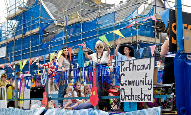 a group of people in costume at the Porthcawl Carnival