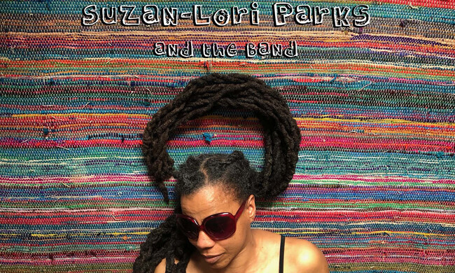 suzan lori parks on a striped background