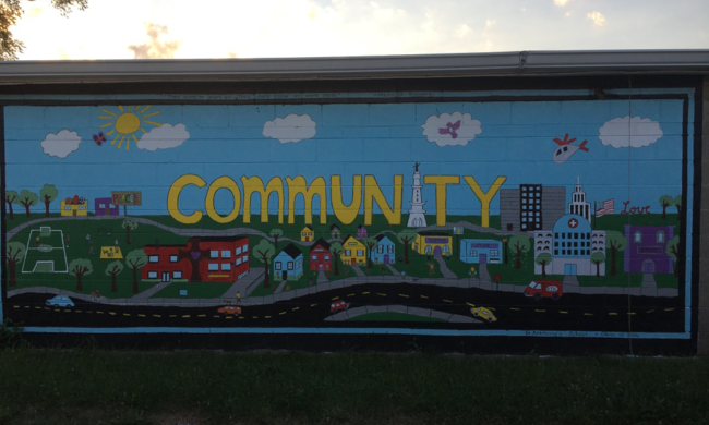 a colorful mural that says community