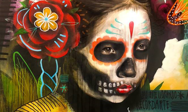"a painting of a girl in Mexican ""day of the dead"" skull makeup."