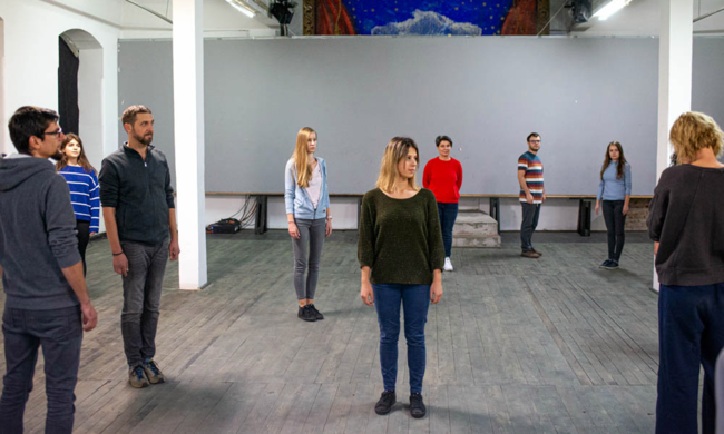 nine people standing in a large space