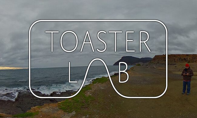 Person on a mountain by water, overlaid with the Toaster Lab logo