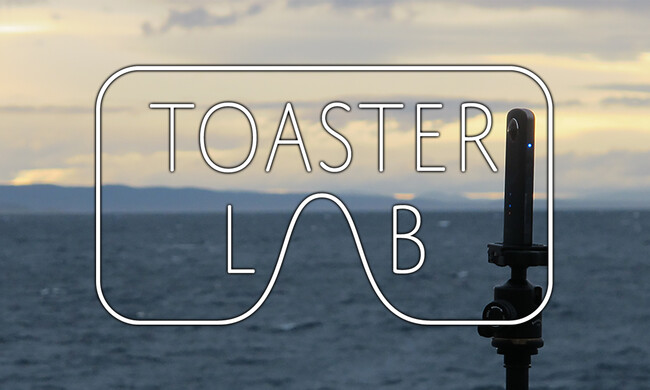 Toaster Lab logo overlaid a camera on a tripod by water.