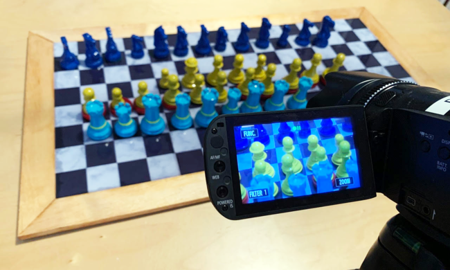 a chess board being video recorded