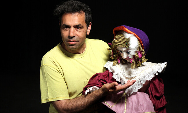 A performer holding a puppet.