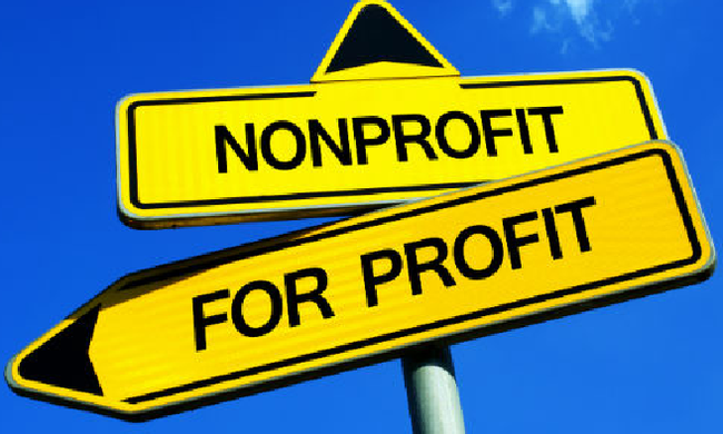 "two signs that say ""nonprofit"" and ""for profit"""