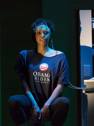 Actor on stage in an Obama biden shirt and wearing a crown