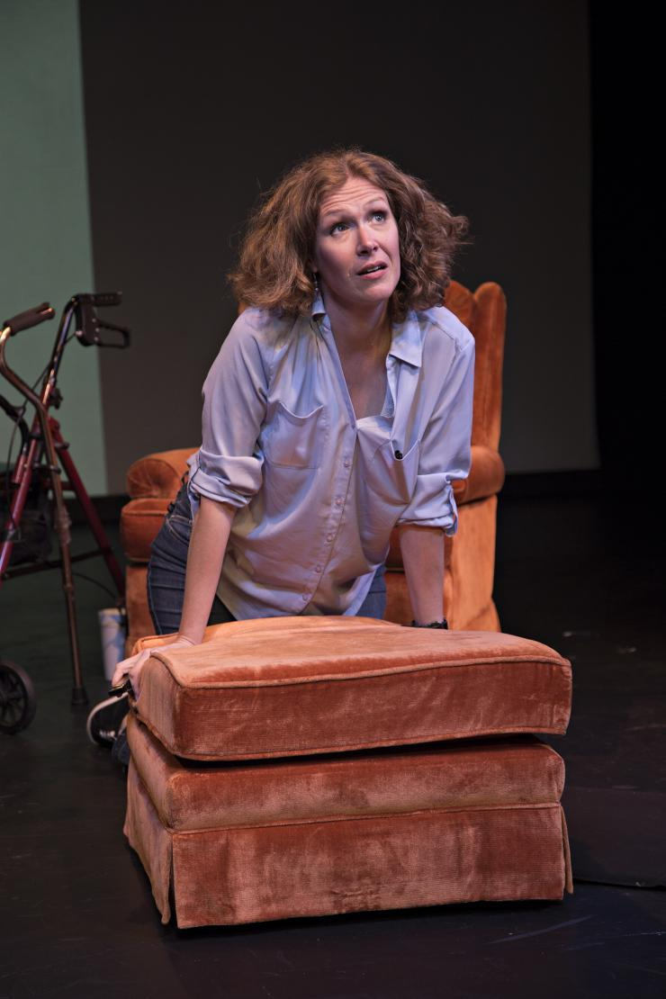 actor sitting in an armchair