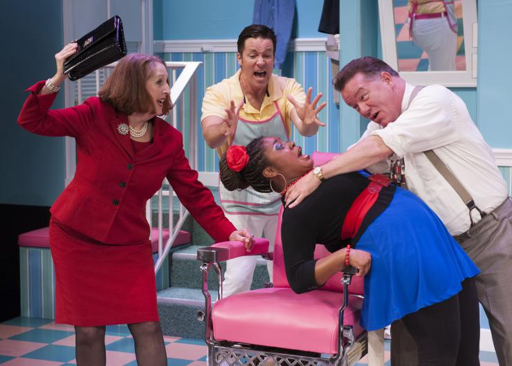 Actors gathered around a barber's chair