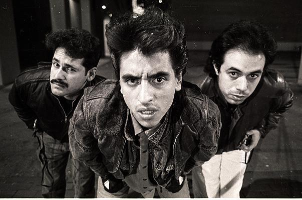 three men looking at the camera