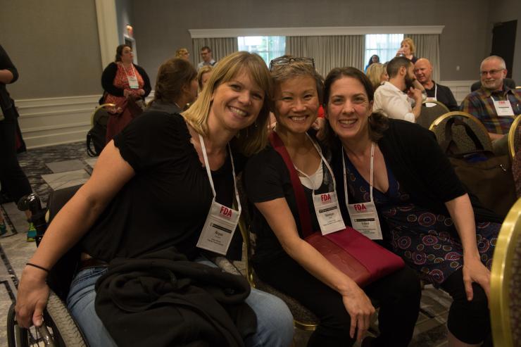 Three women smiling