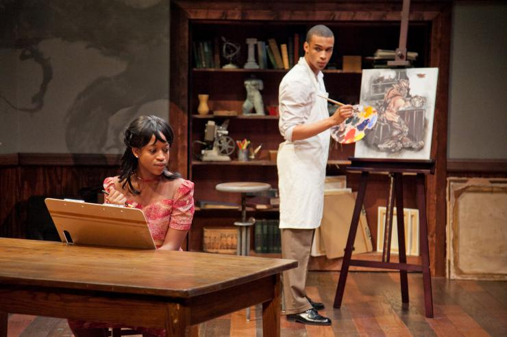 Two actors on stage painting