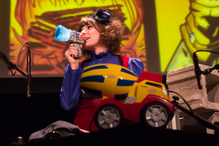 Actor on stage with a toy truck