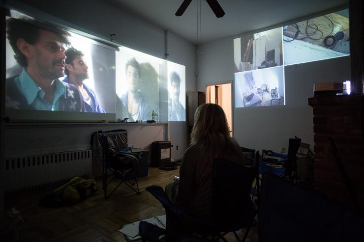 Person in a room watching projections on a wall