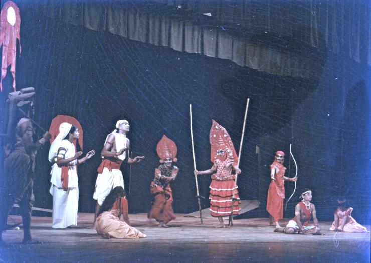 a group of performers onstage in costume