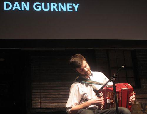 Man playing accordion on stage