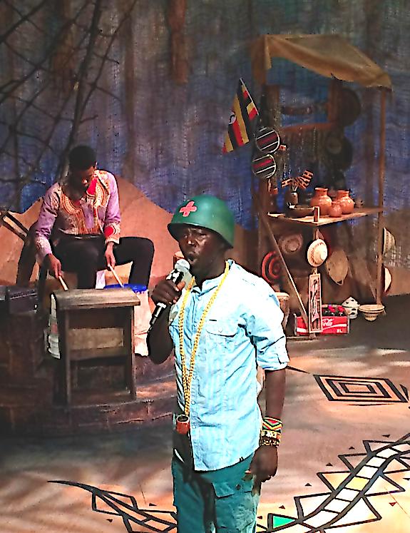 man in a helmet performing on stage