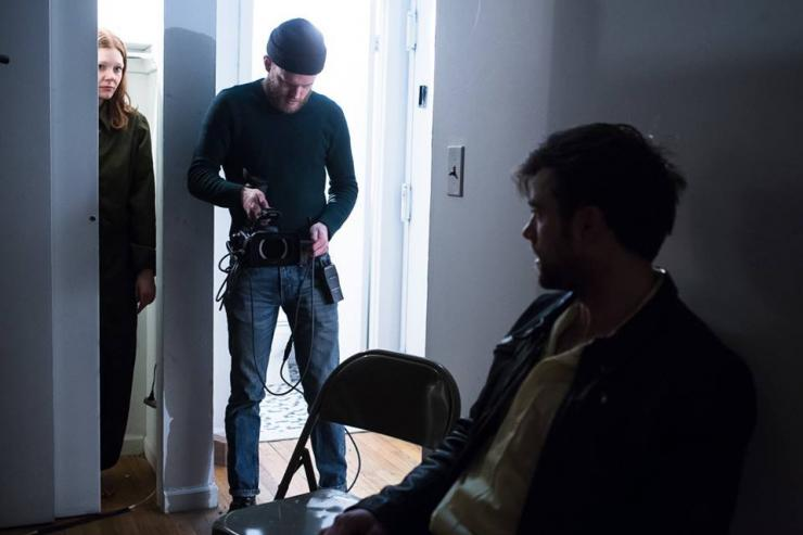 Actor looking at another actor while a cameraperson films