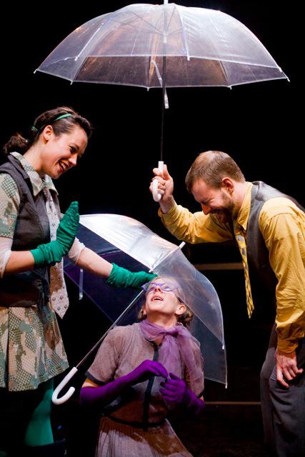 three actors, each holding an umbrella